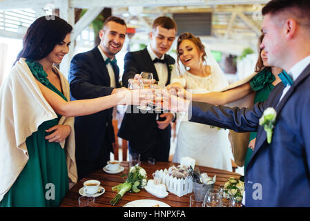 brides wedding day with friends in a cafe - Stock Photo