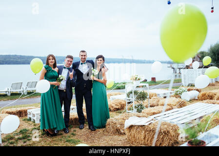 Portrait of a beautiful young drivers and bridesmaids. Wedding. - Stock Photo