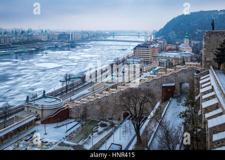 Budapest, Hungary - Panoramic skyline view of the Varkert Bazar and icy River Danube taken from the Buda Castle - Stock Photo