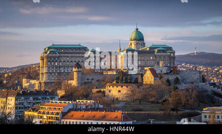 Budapest, Hungary - The famous Buda Castle (Royal Palace), St. Matthias Church and Fishermen's Bastion at sunset - Stock Photo
