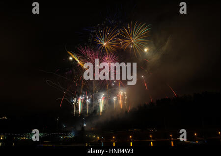 Great fireworks celebration of new year on dark night sky in Prague. Full of colors and sparkling stars. - Stock Photo
