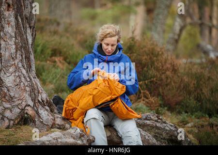 Woman hiking in Scotland - Stock Photo