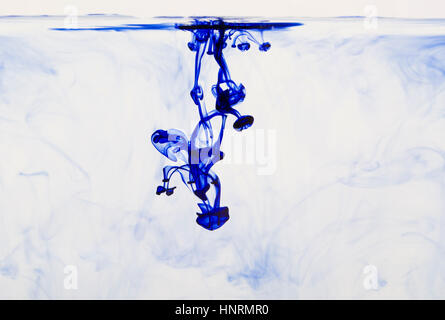 Abstract image of ink flowing in water to make an interesting and unique image. - Stock Photo