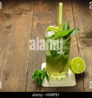 Mojito cocktail with mint leaves and lime - Stock Photo