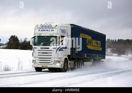SALO, FINLAND - JANUARY 7, 2017: White Scania semi of M. Sorvali Oy hauls curtainsider trailer along snowy road - Stock Photo