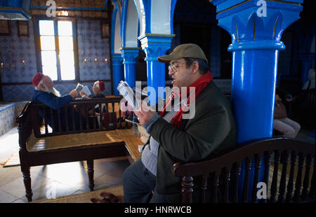 Tunisia.Djerba. Sinagoga de La Griba.Men reading Talmud - Stock Photo
