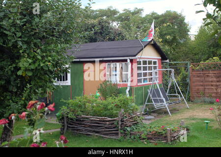 Kleingarten Colonies comprise weekend cottages on small allotments in the city, popular with people whose main home - Stock Photo