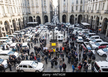 Turin, Italy. 16th Feb, 2017. Italian taxi drivers gather to take part in a demonstration to protest against Uber - Stock Photo