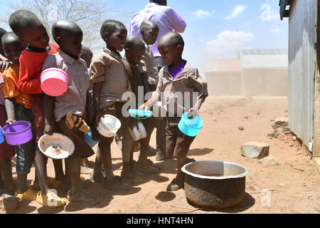 Kajiado, Kenya. 16th February, 2017. Students wash the dishes after lunch at Olomayiana West Primary School in Kajiado - Stock Photo