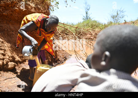Kajiado, Kenya. 16th February, 2017. A Maasai woman fetches water at Olomayiana West, Kajiado County, Kenya, Feb. - Stock Photo