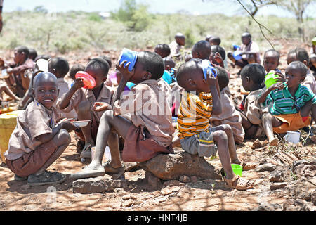 Kajiado, Kenya. 16th February, 2017. Students of the Olomayiana West Primary School enjoy their lunch, porridge - Stock Photo