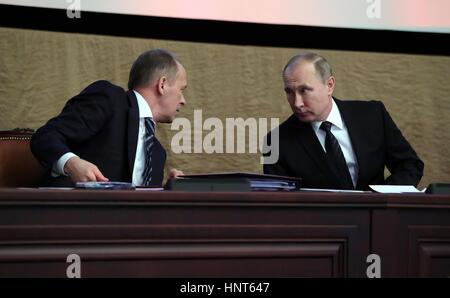 Moscow, Russia. 16th Feb, 2017. Russian President Vladimir Putin listens to Director of the FSB Alexander Bortnikov, - Stock Photo
