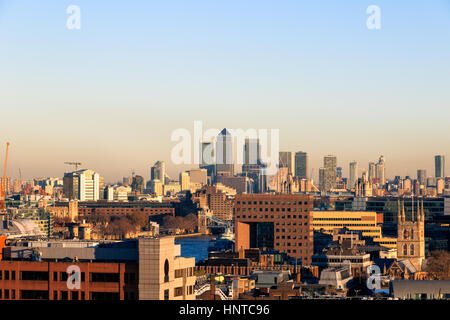 Sunset over financial district cityscape of London, including Canary Wharf - Stock Photo