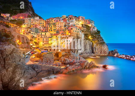 Manarola at evening dusk, Cinque Terre, Liguria, Italy - Stock Photo