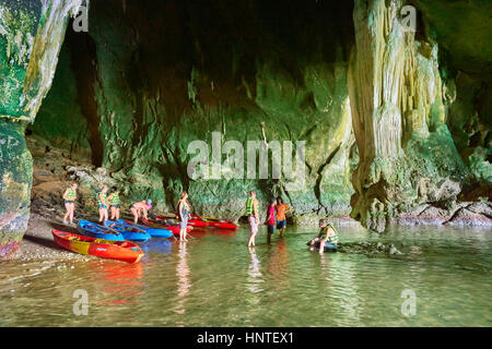 Tourists kayaking and exploring Ko Talabeng Cave, Krabi Province, Thailand - Stock Photo
