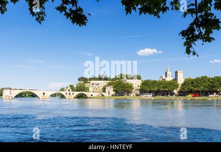 Avignon city skyline and Pont Saint-Bénézet bridge from the Rhone River, Avignon, France - Stock Photo