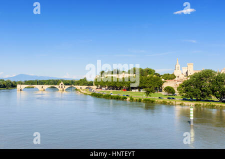 Pont Saint-Bénézet and Avignon Cathedral in the distance, Avignon, France - Stock Photo