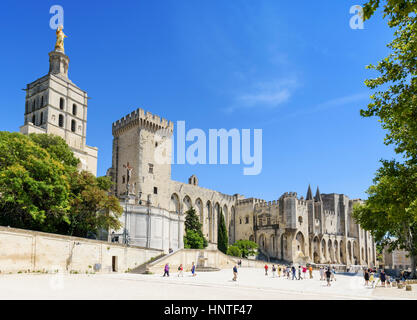 People in Palace Square overlooked by Avignon Cathedral and the Palace of the Popes, Avignon, France - Stock Photo