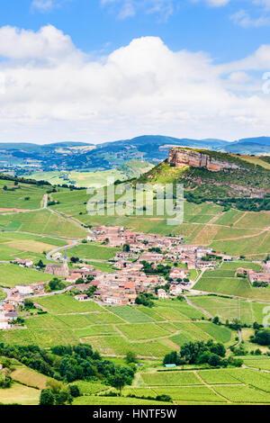 The limestone Roche de Vergisson, overlooking the vineyards and village of Vergisson, Saône-et-Loire, Burgundy-Franche - Stock Photo