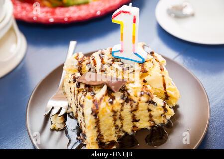 One year cake. Birthday cupcake with number one. Birthday greetings - Stock Photo