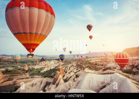 Turkey Cappadocia beautiful balloons flight stone landscape - Stock Photo