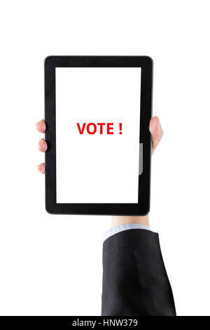 hand of businessman holding digital tablet with word vote isolated on white background with clipping path - Stock Photo