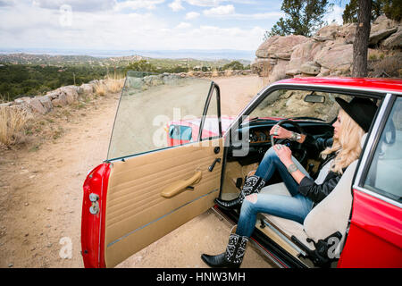 Caucasian woman admiring scenic view from car