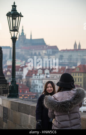 A young Asian girl photograph on Charles Bridge, Prague, Bohemia, Czech republic, Europe - Stock Photo