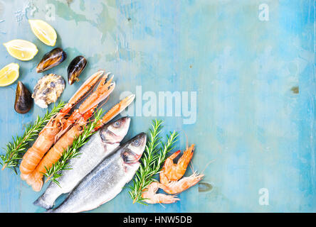 Fresh seafood on blue background - Stock Photo