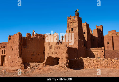 Stork nesting on the Glaoui Kasbah's of Tamedaght in the Ounilla valley set surrounded by the hammada (stoney) desert - Stock Photo