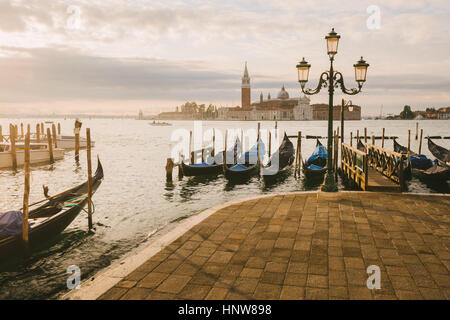 Gondolas in Grand Canal, San Giorgio Maggiore Island in background, Venice, Italy - Stock Photo