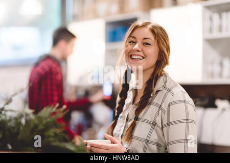 Woman having coffee in cafe - Stock Photo
