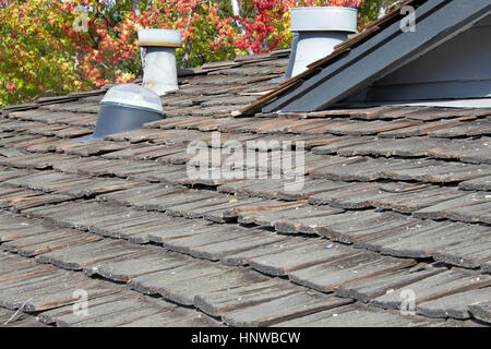 Close Up Of A Worn Shake Shingle Roof Showing Warped