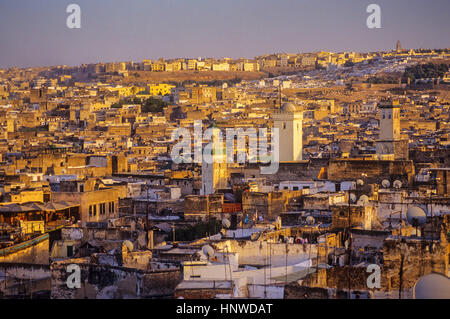 Sunset, skyline. Elevated view over the Medina, UNESCO World Heritage Site, Fez, Morocco, Africa. - Stock Photo