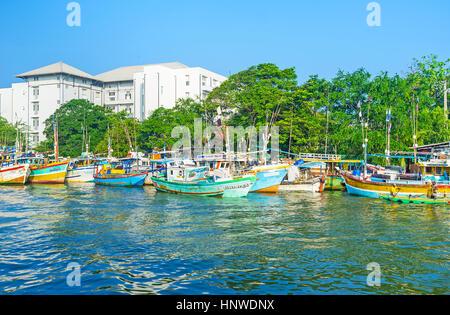 NEGOMBO, SRI LANKA - NOVEMBER 25, 2016: The lagoon is busy fishing place, here locates the port, markets, beaches - Stock Photo