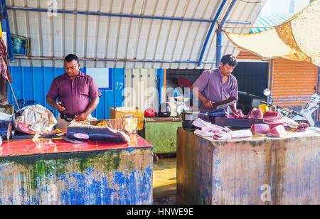 NEGOMBO, SRI LANKA - NOVEMBER 25, 2016: The cutting process of tuna fish at the Main Fish Market, on November 25 - Stock Photo
