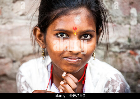 Rishikesh, India - 23 September 2014: The portrait of smiling indian girl on the street on 23 September 2014 in - Stock Photo