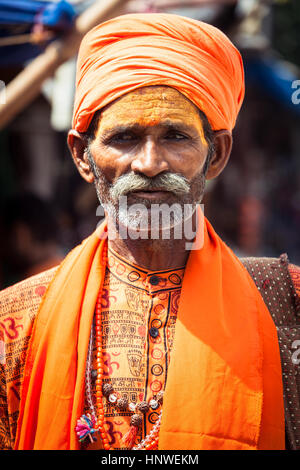 Rishikesh, India - September 22, 2014: The portrait of the indian 'Holy Man' in orange traditional clothes on the - Stock Photo