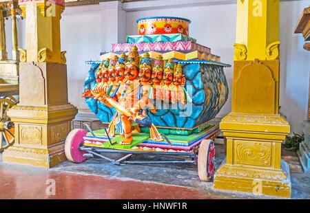 MUNNESWARAM, SRI LANKA - NOVEMBER 25, 2016: The festival cart in Munneswaram Kovil with the sculpture of nine-headed - Stock Photo