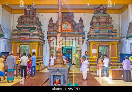 MUNNESWARAM, SRI LANKA - NOVEMBER 25, 2016: Interior of Shiva Temple in Munneswaram Kovil, worshipers come with - Stock Photo