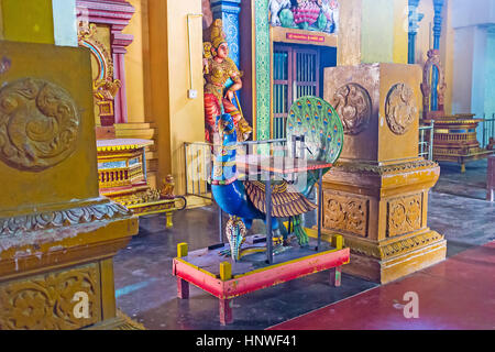 MUNNESWARAM, SRI LANKA - NOVEMBER 25, 2016: The sculpture of peacock (the vehicle of Skanda) in Munneswaram Kovil, - Stock Photo