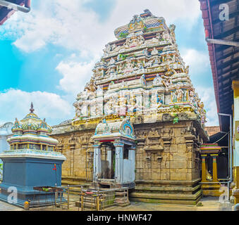 The dome of old Hindu Temple in Munneswaram traditionally decorated with numerous sculptures of Gods, Sri Lanka. - Stock Photo