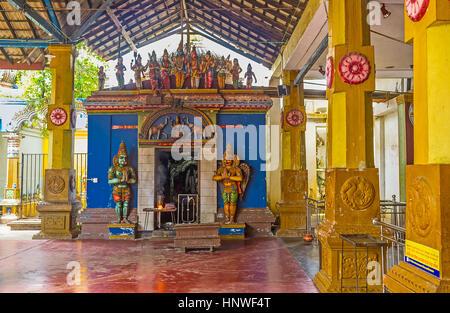 MUNNESWARAM, SRI LANKA - NOVEMBER 25, 2016: The richly decorated interior of Munneswaram Kovil - brightly colored - Stock Photo