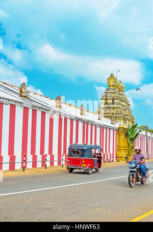 MUNNESWARAM, SRI LANKA - NOVEMBER 25, 2016: The colorful wall of the Munneswaram Temple with the richly decorated - Stock Photo
