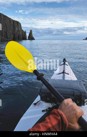 Point of view image of kayaker sea kayaking, Trinity Bay, Newfoundland, Canada - Stock Photo