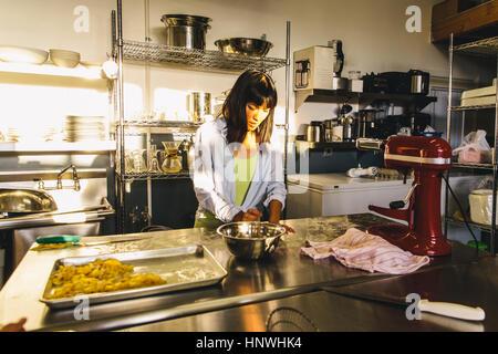 Student at pasta making class - Stock Photo