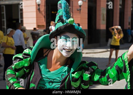 A street entertainer smiles at the camera outside the hotel Ambos Mundos in Havana Vieja Cuba - Stock Photo