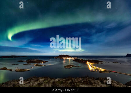 Aurora Borealis in the night sky over Sommaroy Bridge crossing from Kvaloya Island to Sommaroy island, Arctic Norway - Stock Photo