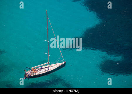 High angle view of yacht in turquoise sea, Majorca, Spain - Stock Photo