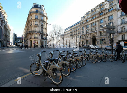 A Velib station in Boulevard Haussmann with rental bicycles for hire by the public in Paris, France - Stock Photo